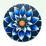 "4"" round absorbent stone coaster featuring a blue flower art by Michigan artist Denise Cassidy Wood."