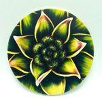 "4"" round absorbent stone coaster featuring a green flower art by Michigan artist Denise Cassidy Wood."