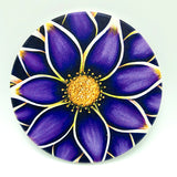 "4"" round absorbent stone coaster featuring a purple flower art by Michigan artist Denise Cassidy Wood."