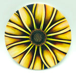 "4"" round absorbent stone coaster featuring a yellow flower art by Michigan artist Denise Cassidy Wood."