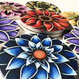 "4"" round absorbent stone coasters featuring flower art by Michigan artist Denise Cassidy Wood."