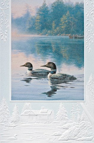 An embossed birthday card featuring loons on a misty pond.  Artwork by Darrell Bush. Pumpernickel Press cards are made in the USA using agricultural-based inks.