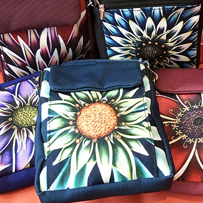 Lightweight crossbody purse featuring a vibrant flower by Michigan artist Denise Cassidy Wood with adjustable strap.