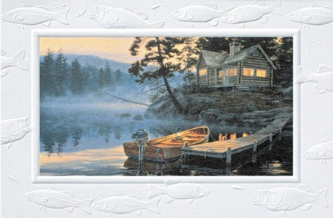 An embossed birthday card featuring a boat tied to a lake dock near a log cabin.  Artwork by Darrell Bush.