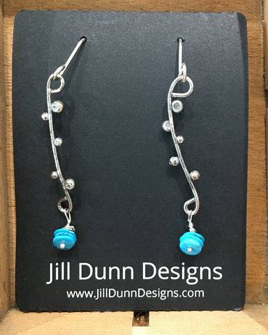 Sterling silver vertical earrings w/ turquoise beads by Jill Dunn.