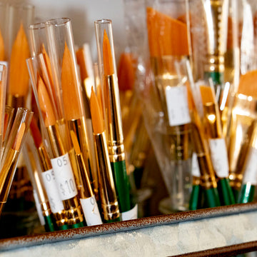 Array of fine nylon watercolor brushes.