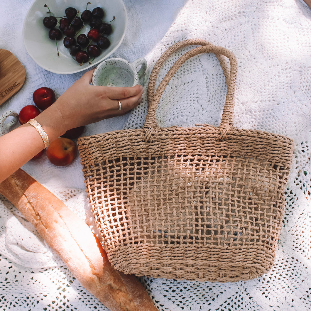 picnic with woven bag