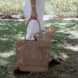 Picnic at the park with the handmade woven bag made from wheat