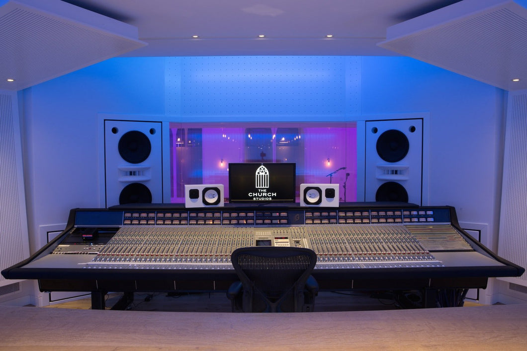 White Augspurger Duo-15 Speaker System front view in music studio.
