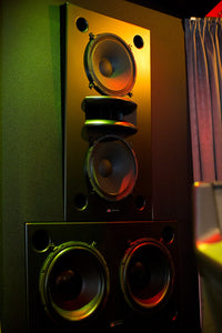 Black Augspurger Duo-15 Speaker System front view in music studio.