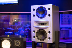 White Augspurger Duo-8 Single Speaker on Stand in music studio.