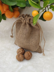 Walnuts in their shell in a canvas bag