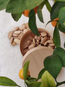 Almonds without skin in a wooden box