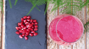 Freshly squeezed pomegranate juice in a 300 ml glass bottle
