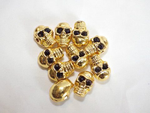 Rhodium plated zinc alloy skull beads in gold colour