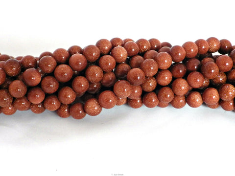 Goldstone round beads - 8mm