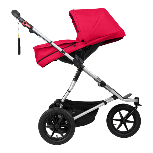 Mountain Buggy carrycot plus on urban jungle buggy in parent facing seat mode in colour berry_berry