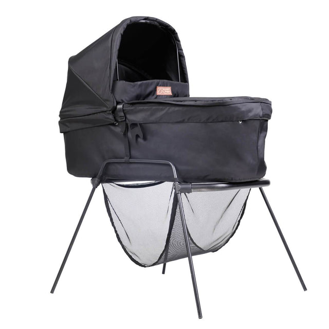 mountain buggy swift and mini carrycot plus in lie flat mode on carrycot stand shown in color black_black