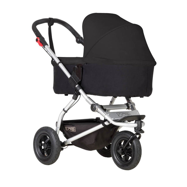 mountain buggy swift compact buggy with carrycot plus in lie flat mode 3/4 view shown in color black_black