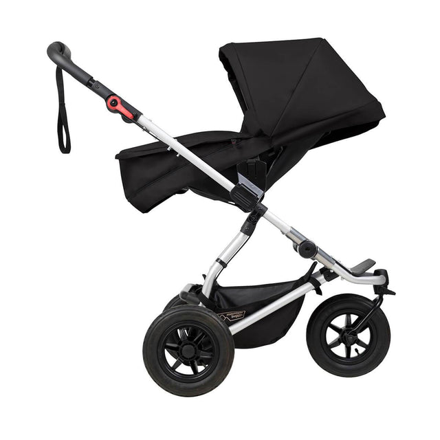 mountain buggy swift compact buggy with carrycot plus in parent facing mode side view shown in color black_black