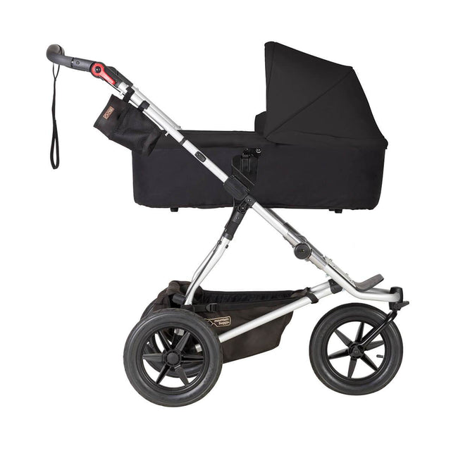 Mountain Buggy carrycot plus on urban jungle buggy in lie flat mode in colour black_black