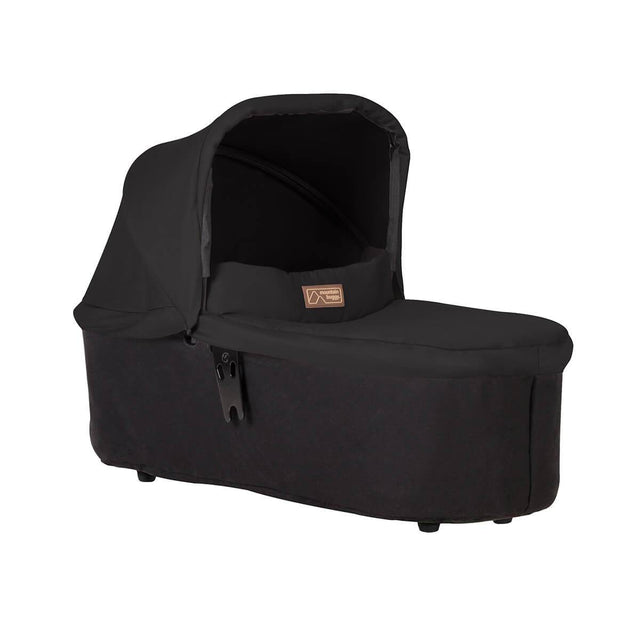 mountain buggy swift and mini carrycot plus in lie flat mode 3/4view shown in color black_black