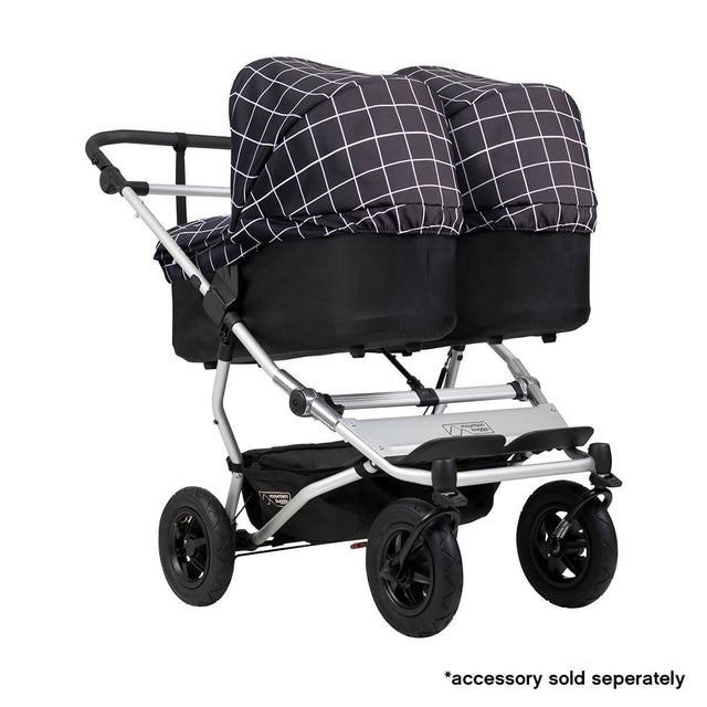 Mountain Buggy duet double buggy fitted with two carrycot plus in parent facing seat position in colour grid_grid