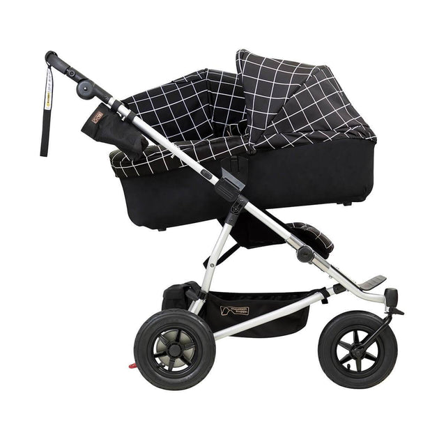 mountain buggy duet double buggy with one carrycot plus in incline mode side view shown in color grid_grid