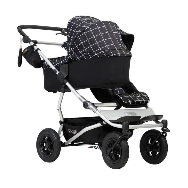 mountain buggy duet double buggy with one carrycot plus in lie flat mode 3/4 view shown in color grid_grid