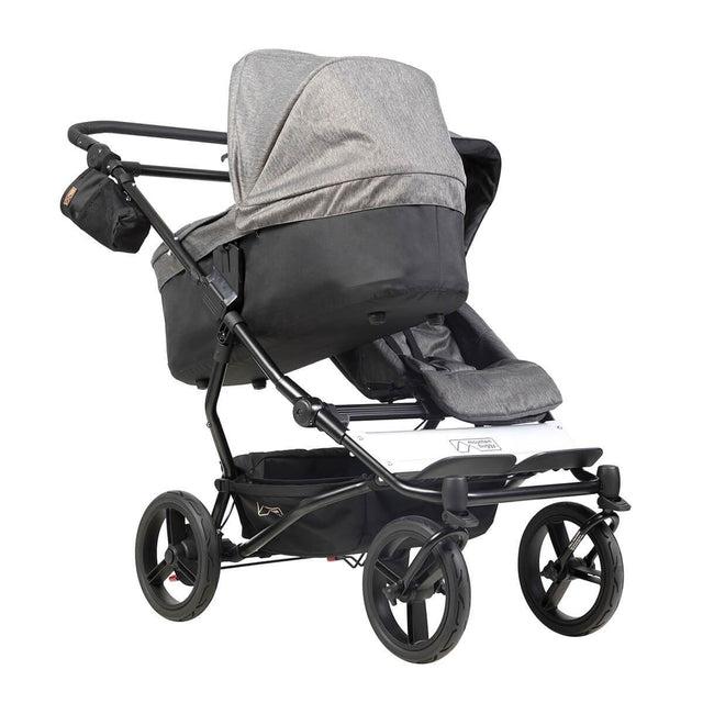 mountain buggy duet double buggy with one carrycot plus in incline mode 3/4 view shown in color herringbone_herringbone