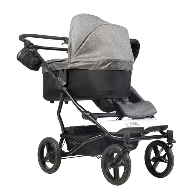 mountain buggy duet double buggy with one carrycot plus in lie flat mode 3/4 view shown in color herringbone_herringbone