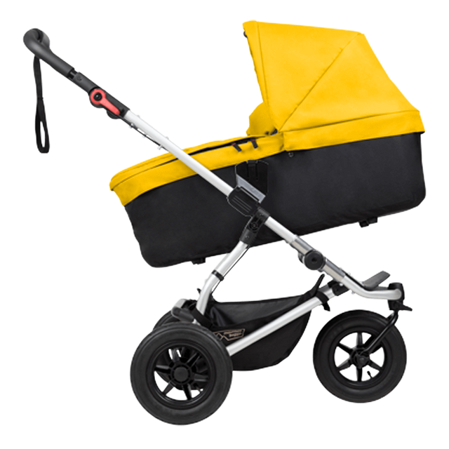 mountain buggy swift compact buggy with carrycot plus side view in incline mode shown in color gold_gold