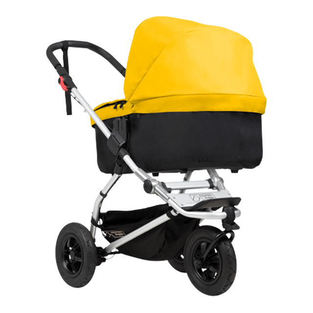 mountain buggy swift compact buggy with carrycot plus in lie flat mode 3/4 view shown in color gold _gold