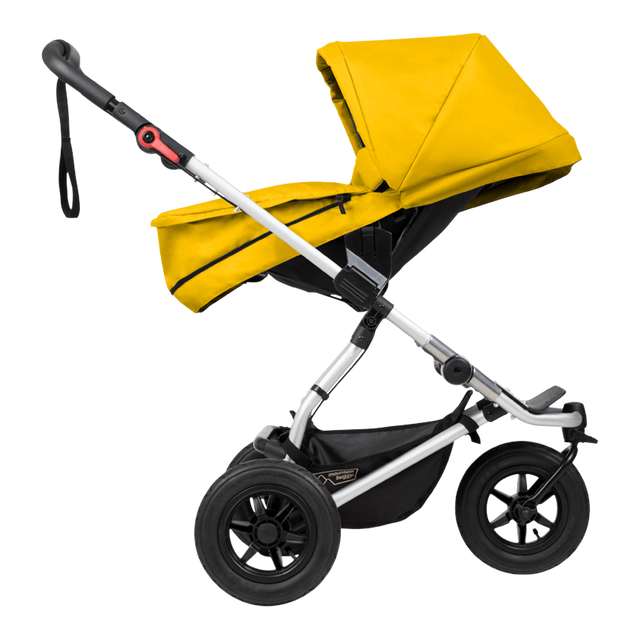 mountain buggy swift compact buggy with carrycot plus in parent facing mode side view shown in color gold_gold