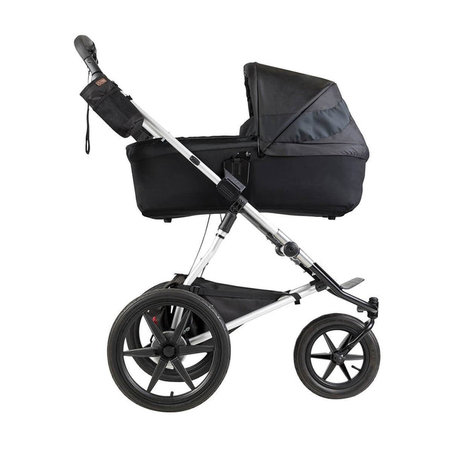 Mountain Buggy carrycot plus on terrain in lie flat mode in colour onyx_onyx