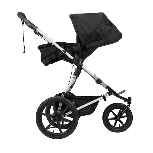Mountain Buggy carrycot plus on terrain in parent facing mode in colour onyx_onyx