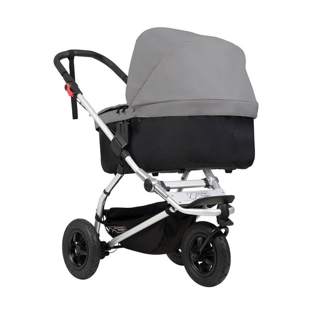 mountain buggy swift compact buggy with carrycot plus in lie flat mode 3/4 view shown in color silver_silver