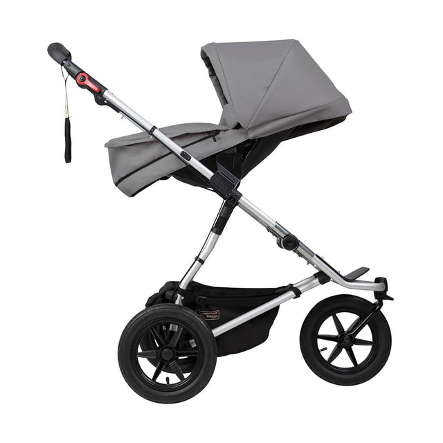 Mountain Buggy carrycot plus on urban jungle in parent facing mode in colour silver_silver