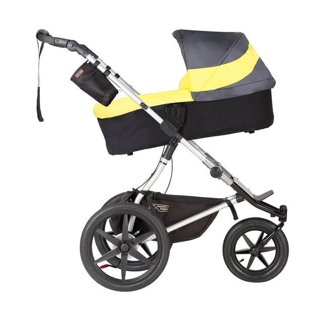 Mountain Buggy carrycot plus on terrain in incline mode in colour solus_solus