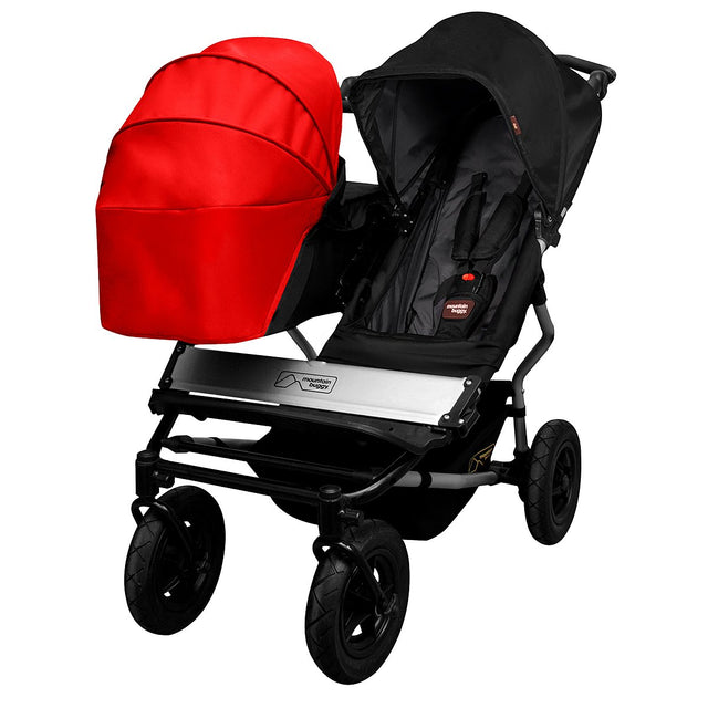 mountain buggy pre-2015 swift mini and pre-2014 duet carrycot sunhood on a duet carrycot 3/4 view shown in color chilli_chilli