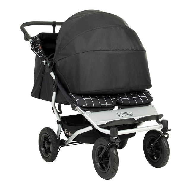 Mountain Buggy® newborn cocoon for twins shown as an example installed on the duet buggy