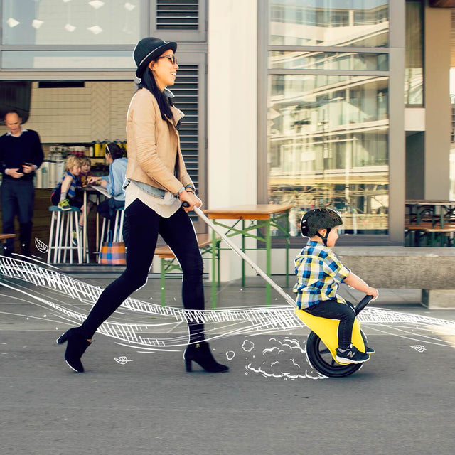 Mountain Buggy unirider with mum pushing her son in the city_yellow