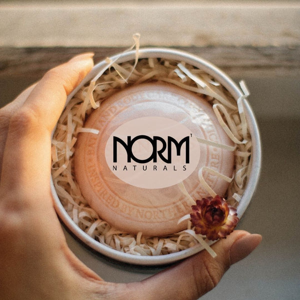 person holding norm naturals soap