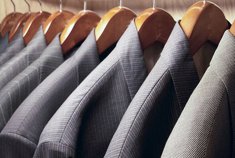 Selection of hanging bespoke suits