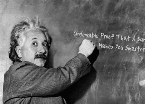 Albert Einstein writing Undeniable Proof That A Suit Makes You Smarter on a blackboard