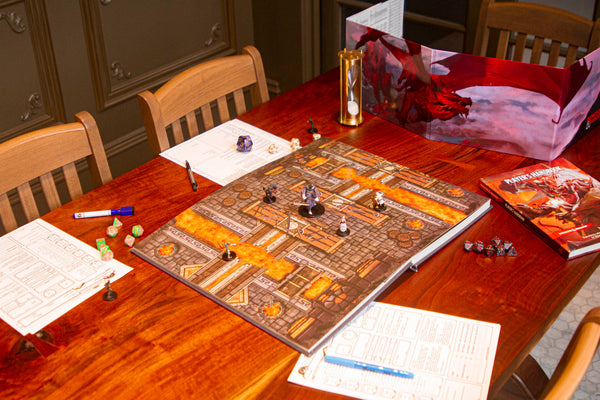 Immersive Battlemaps is a book that opens up to reveal over 30 full maps for playing table top games.