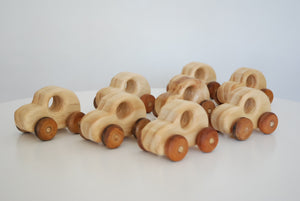 large selection of mini cars made from wood