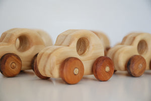 group of mini wooden cars with dark wood tyres