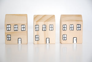 row of little wooden toy house blocks