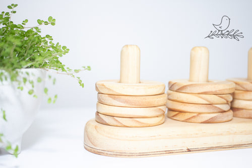 A wooden baby toy for stacking
